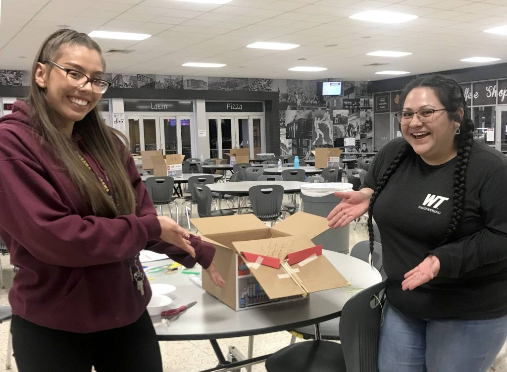 Two students showcasing a prototype from the Engineering Design Challenge at the 2020 Amarillo Divisional STEM Competition.