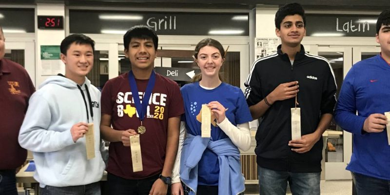 Students holding ribbons during the awards ceremony for the 2020 Amarillo Divisional STEM Competition.
